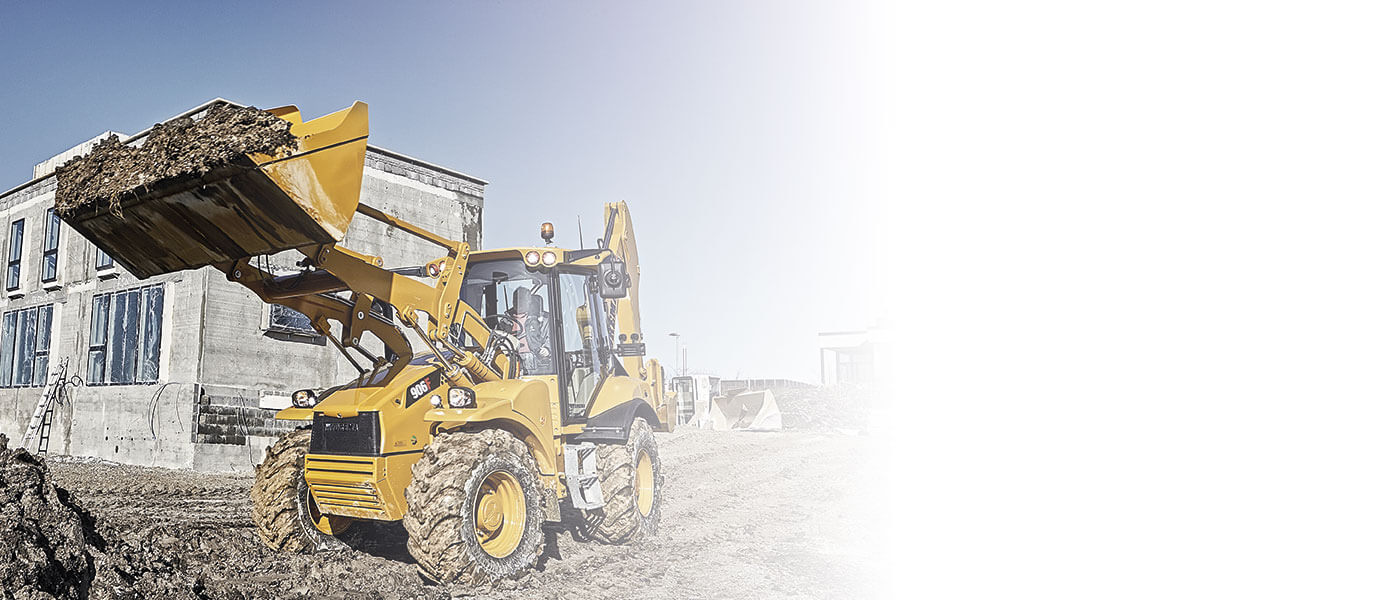 Hydrema 906F backhoe loader loading soil