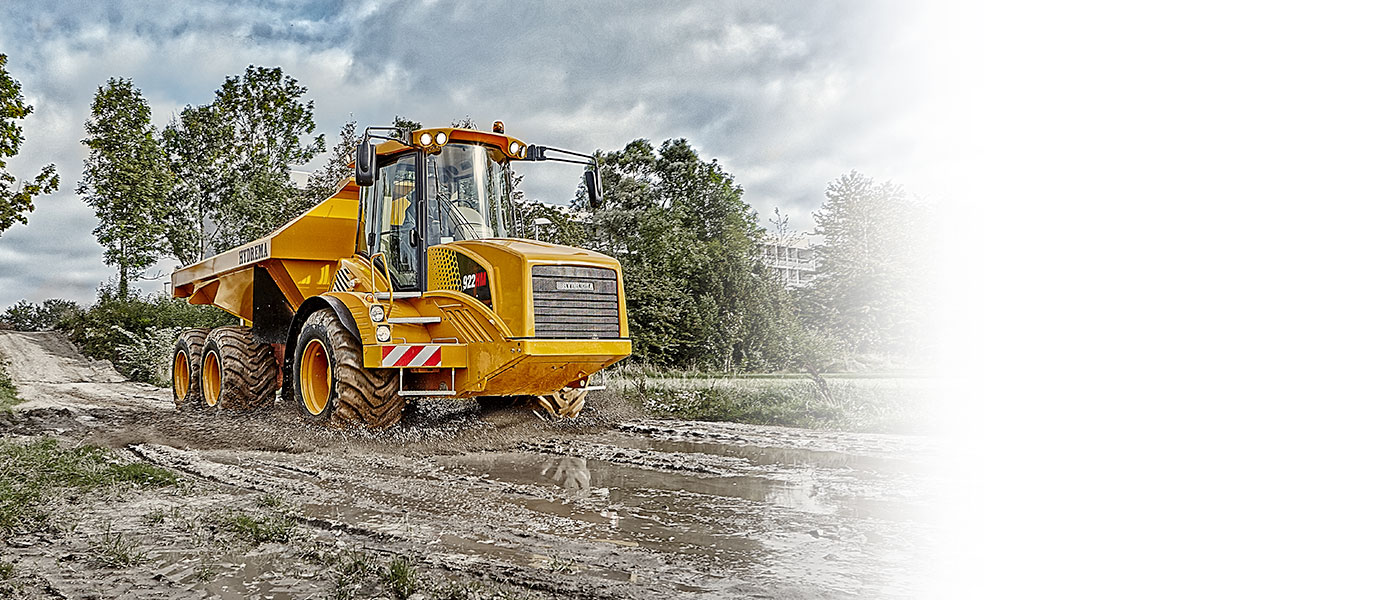 Hydrema 922F-Series dump truck driving in muddy terrain