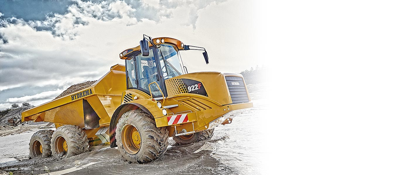 Hydrema 922F-Series dump truck driving through water with full load