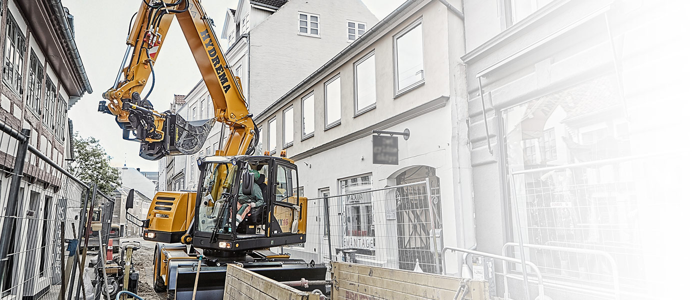 Hydrema MX16 excavator working on a city street excavating