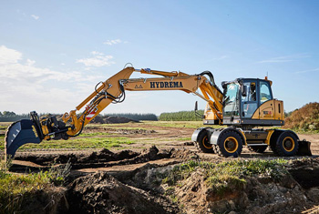 Hydrema MX16 excavator digging with it