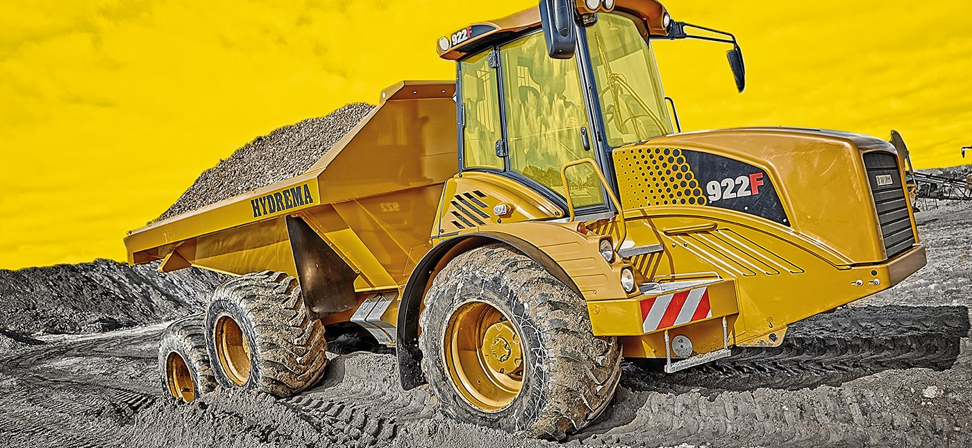 Hydrema 922F-Series dump truck moving gravel in rough terrain
